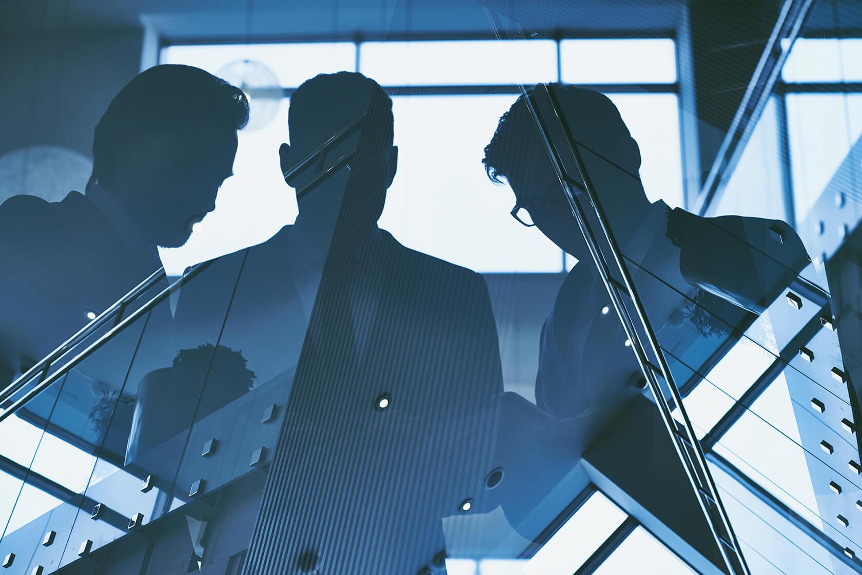 reflection of three men